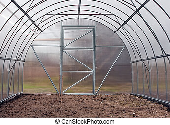 greenhouse - New modern greenhouse with bed in spring