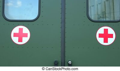 New modern military ambulance close up. Detail view of the back door of army medical truck with crosses. Medical evacuation service.