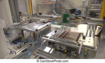 robot working at factory - new modern robot working at...