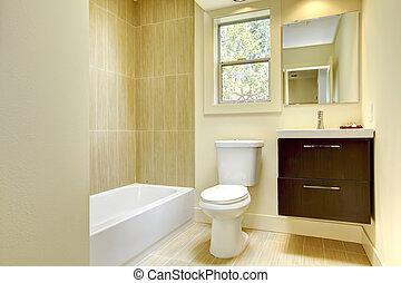 New modern yellow bathroom with beige tiles.