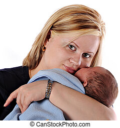 New Mommy - Closeup of a new mom holding her newborn boy. ...