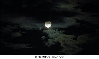 New Moon and Clouds in the Pitchblack Sky - New moon and...