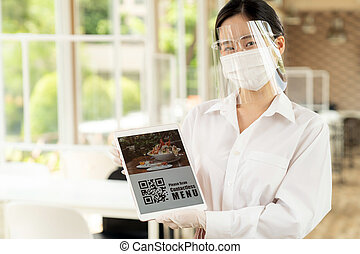 New Normal asian waitress hold qr code contactless menu ...