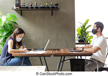 New normal people coworker meeting with protective mask for coronavirus spread