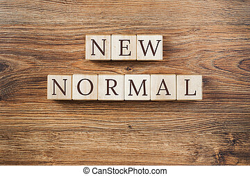 New Normal text on wooden building blocks