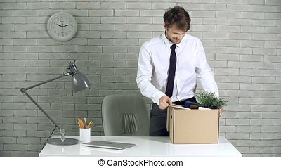 New Opportunities - Close up of new employee unpacking his...