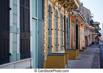 New Orleans Houses - A rustic set of doors and shutters in...