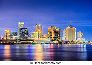 New Orleans, Louisiana, USA night skyline on the Mississippi...