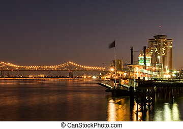 New Orleans waterfront - Hotels and bridge over Mississippi ...