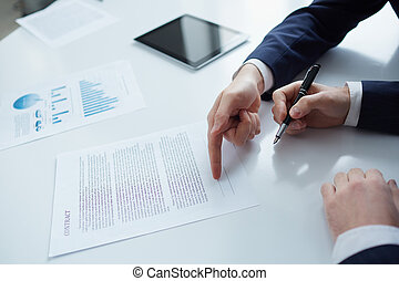 New partnership - Two businessmen while signing a contract