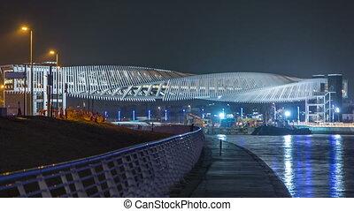New pedestrian bridge over the Dubai Water Canal illuminated at night timelapse. United Arab Emirates, Middle East