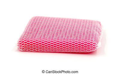 New pink kitchen sponge on white background.