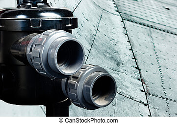 New pipes against steel background