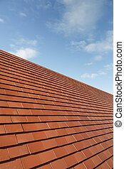 New plain clay roof tiles