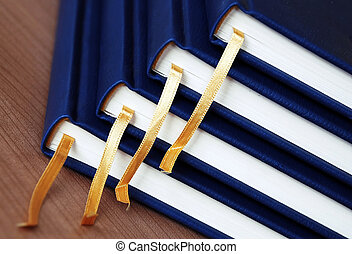 new blue organizers yellow bookmarks closeup on office desk