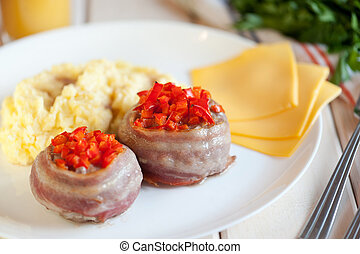 New portioned snack with bacon on a white wooden table