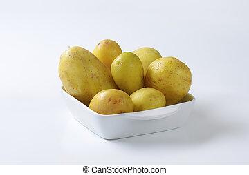 New potatoes in ceramic dish