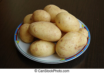 new fresh spring potatoes on plate