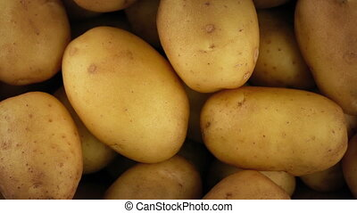 New Potatoes Rotating Closeup - Overhead closeup shot of new...