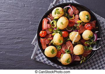 new potatoes with bacon, onion and tomato horizontal top view