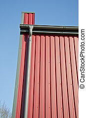 new rain gutters tube on modern house wall