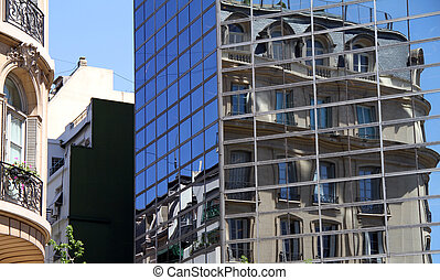 New Reflects Old - A Modern office building windows reflect...