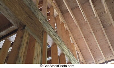 New residential construction house framing against a blue...