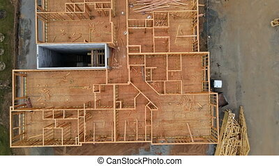New residential with wooden truss post and beam stick built construction framing