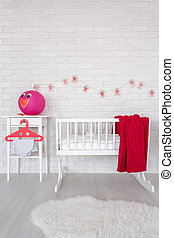 New room for a baby - Shot of a modern red and white baby ...