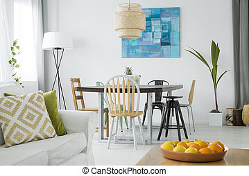 New room with dining table, white couch and lamp