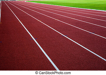 New running track with green grass,