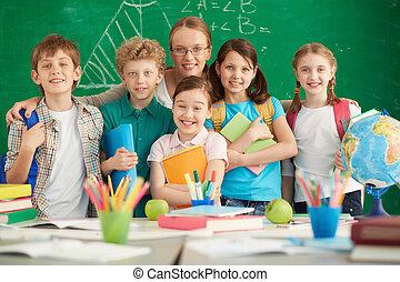 New school year - Portrait of cute schoolchildren and their...