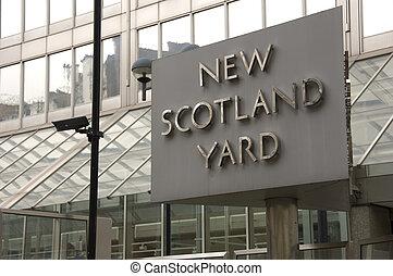 New Scotland Yard - Sign outside New Scotland Yard the...