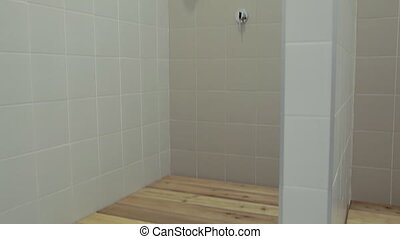 New shower cabin with ceramic tile and wooden covering