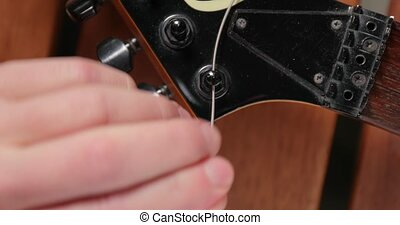Putting new string on an electric guitar