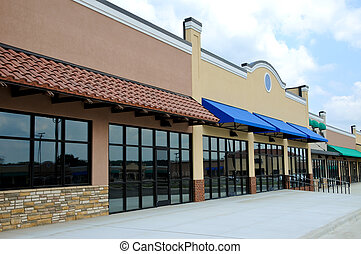 New Strip Mall - Store Fronts in a New Shopping Center