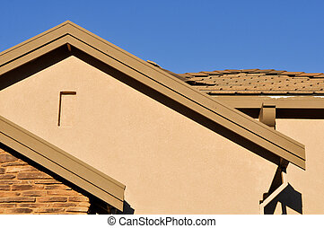 New Stucco Home Under Construction with Blue Sky