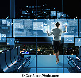 New technologies - Image of businesswoman pushing icon on ...