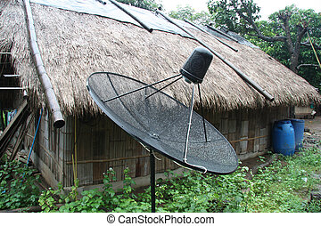 New technologies in the old world, satellite dish in a thai...