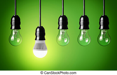 new technology - Glowing LED bulb and simple light bulbs
