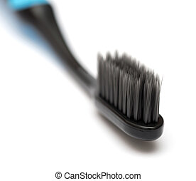 new toothbrush close-up on white background