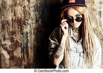 new trend - Modern teenage girl with blonde dreadlocks over...