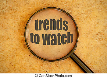 New trends - Magnifying glass over trends to watch text
