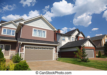 New two-storied white-brown brick cottage with beige garage.