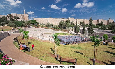 New urban Teddy Park and Tower of David on background under blue sky timelapse hyperlapse in Jerusalem, Israel.