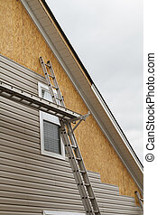 New Vinyl Siding Installation On A Home In The South