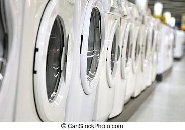 wash machine - new wash machines in row at supermarket