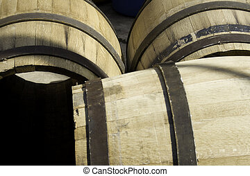 New wine barrels stored in rows