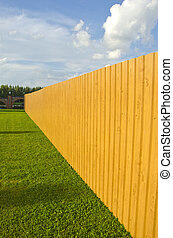new wooden and painted fence in farm