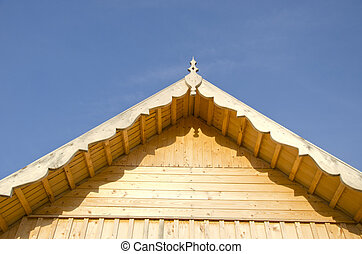 new wooden farm house roof and wall fragment